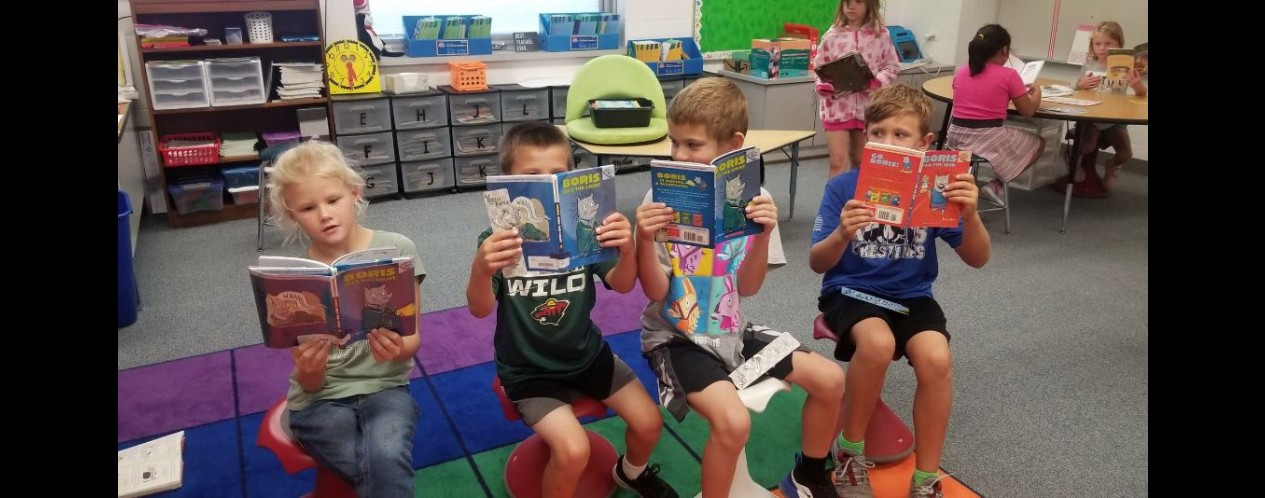 Photograph of Ms Anderson's students reading